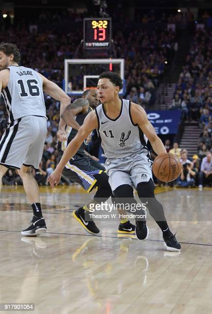 Bryn Forbes of the San Antonio Spurs dribbles around a screen set by teammate Pau Gasol on Andre Iguodala of the Golden State Warriors during an NBA...