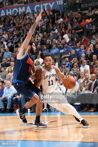 Bryn Forbes of the San Antonio Spurs drives to the basket against Alex Abrines of the Oklahoma City Thunder on December 3 2017 at Chesapeake Energy...