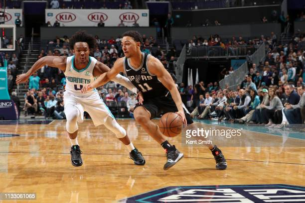 Bryn Forbes of the San Antonio Spurs handles the ball against the Charlotte Hornets on March 26 2019 at the Spectrum Center in Charlotte North...