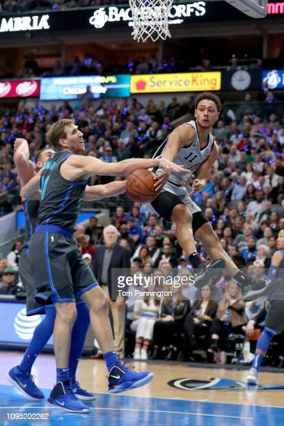 Bryn Forbes of the San Antonio Spurs passes the ball against Dirk Nowitzki of the Dallas Mavericks in the second half at American Airlines Center on...