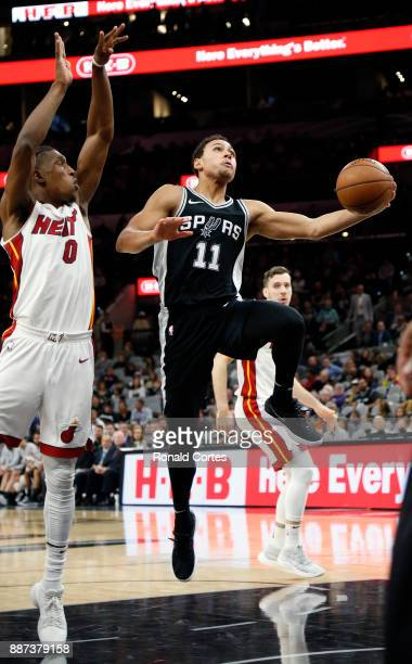 Bryn Forbes of the San Antonio Spurs scores two in front Josh Richardson of the Miami Heat at ATT Center on December 06 2017 in San Antonio Texas...