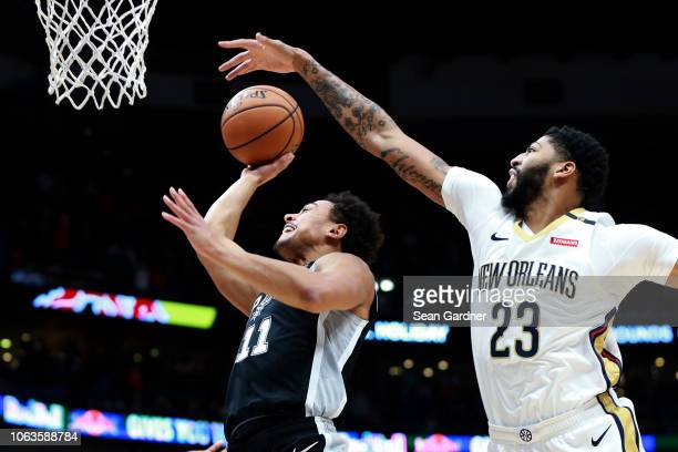 Bryn Forbes of the San Antonio Spurs shoots over Anthony Davis of the New Orleans Pelicans at the Smoothie King Center on November 19 2018 in New...