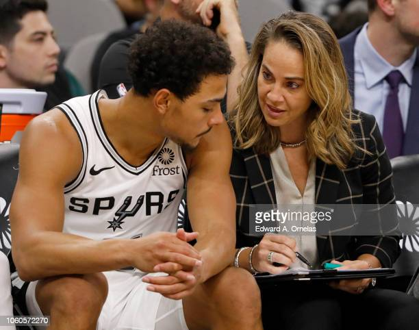 Bryn Forbes of the San Antonio Spurs talks with San Antonio Spurs assistant coach Becky Hammon during an NBA game against the Indiana Pacers on...