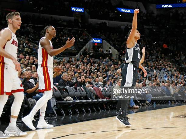 Bryn Forbes of the San Antonio Spurs watches his tree as does Josh Richardson of the Miami Heat and Goran Dragic of the Miami HeatL at ATT Center on...