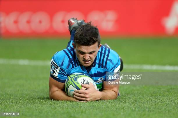 Bryn Gatland of the Blues dives over to score a try during the round two Super Rugby match between the Highlanders and the Blues at Forsyth Barr...