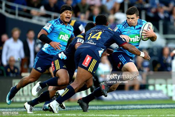 Bryn Gatland of the Blues fends off Waisake Naholo of the Highlanders during the round two Super Rugby match between the Highlanders and the Blues at...