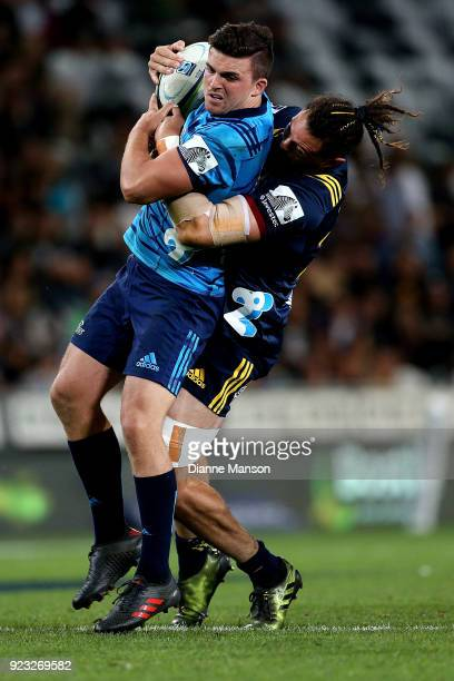 Bryn Gatland of the Blues is tackled by Elliot Dixon of the Highlanders during the round two Super Rugby match between the Highlanders and the Blues...