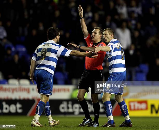 Bryn Gunnarsson and Shane Long of Reading argue with referee Oliver Langford during the CocaCola Football League Championship match between Reading...