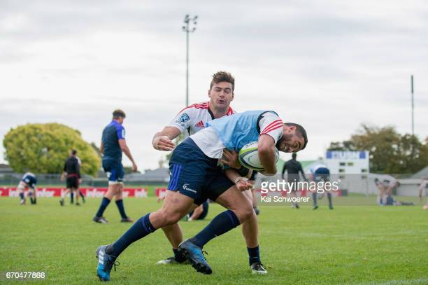 Bryn Hall is tackled by David Havili during a Crusaders training session at Rugby Park on April 20 2017 in Christchurch New Zealand