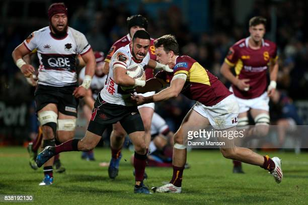 Bryn Hall of North Harbour fends off Lewis Ormond of Southland during the Mitre 10 Cup match between Southland and North Harbour at Rugby Park...