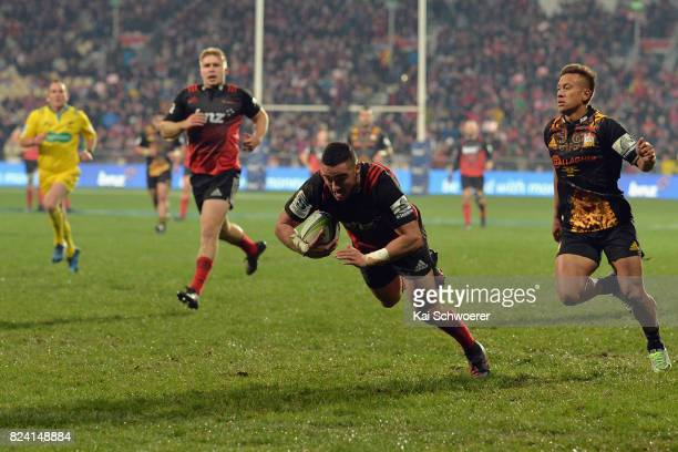 Bryn Hall of the Crusaders dives over to score a try during the Super Rugby Semi Final match between the Crusaders and the Chiefs at AMI Stadium on...