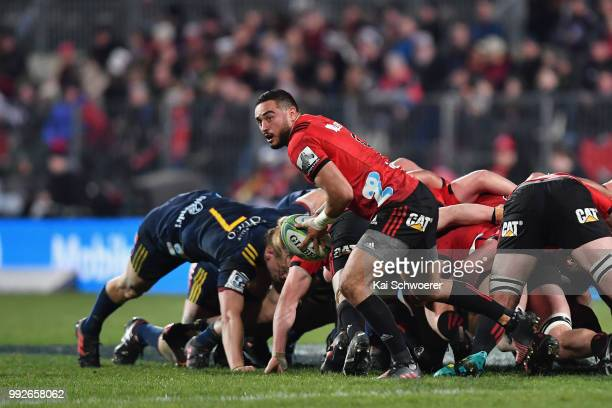 Bryn Hall of the Crusaders looks to pass the ball during the round 18 Super Rugby match between the Crusaders and the Highlanders at AMI Stadium on...