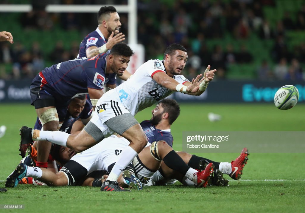 Bryn Hall of the Crusaders releases the ball during the round 12 Super Rugby match between the Rebels and the Crusaders at AAMI Park on May 4, 2018 in Melbourne, Australia.