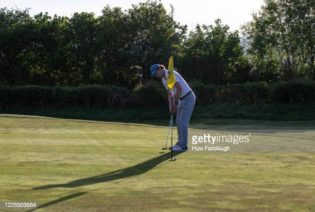 Bryn Meadows Golf Club Captain Darren Brownsinks sinks the first hole as restrictions on playing golf in Wales have been eased but still differ to...