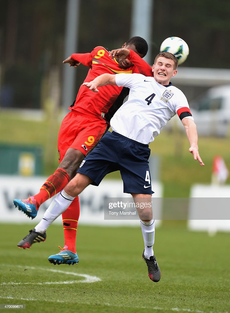 Bryn Morris of England challenged in the air by Mamadou Obbi Oulare of Belgium during the U18 International Friendly match between England and Belgium at St Georges Park on February 18, 2014 in Burton-upon-Trent, England.