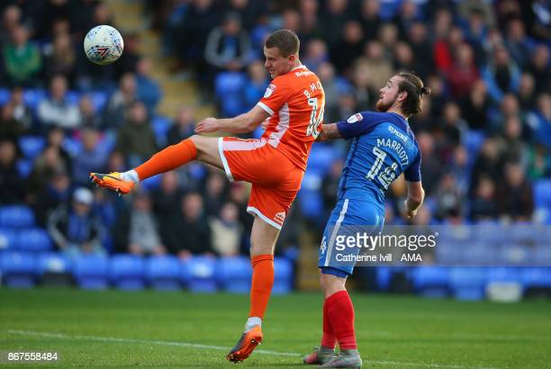 Bryn Morris of Shrewsbury Town and Jack Marriott of Peterborough United during the Sky Bet League One match between Peterborough United and...