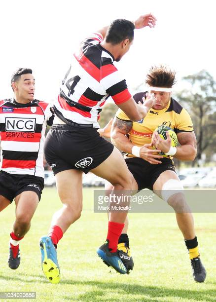 Brynard Stander of the Force brushes off a tackle by Lausii Taliauli of the Vikings during the round three NRC match between Canberra Vikings and...
