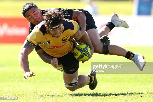 Brynard Stander of the Force gets tackled by Jaline Graham of the Eagles during the round two NRC match between Western Force and NSW Country Eagles...