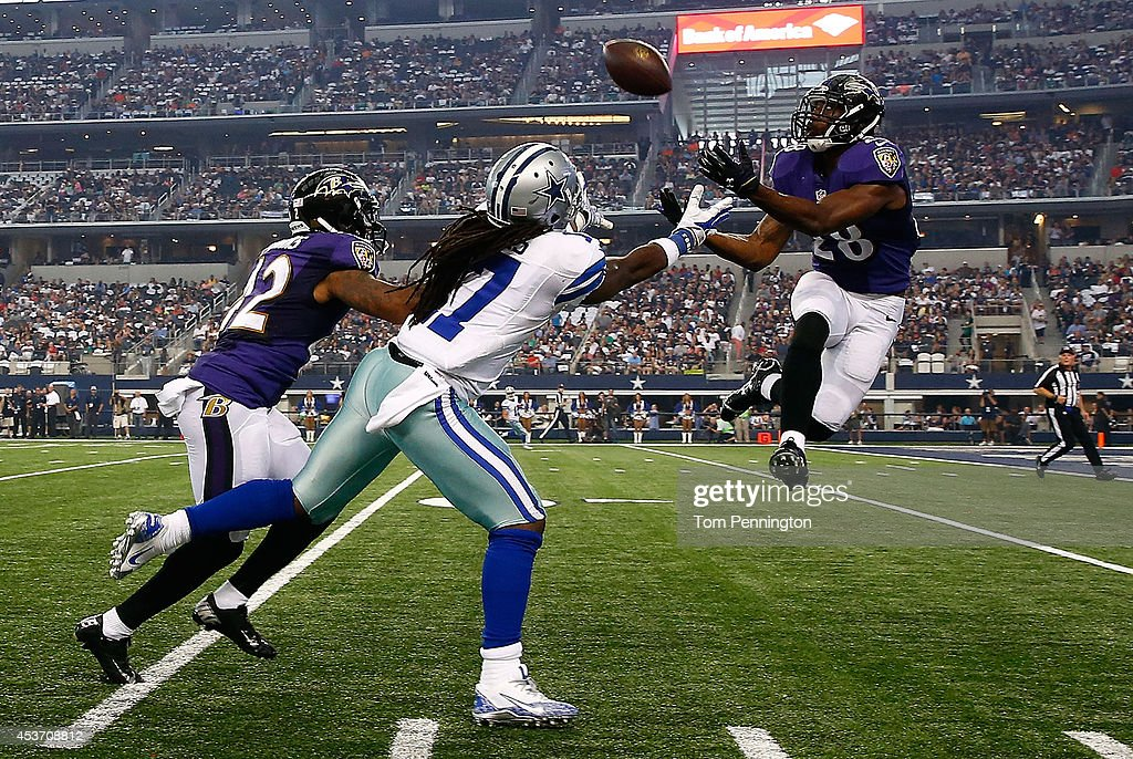 Brynden Trawick #28 of the Baltimore Ravens intercepts a pass intended for Dwayne Harris #17 of the Dallas Cowboys in the first half of their preseason game at AT&T Stadium on August 16, 2014 in Arlington, Texas.