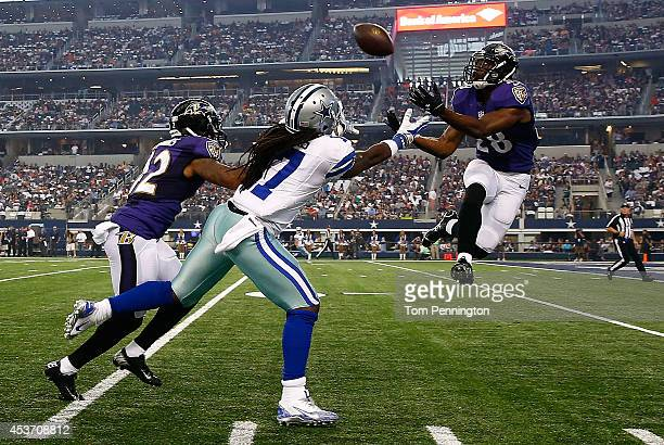 Brynden Trawick of the Baltimore Ravens intercepts a pass intended for Dwayne Harris of the Dallas Cowboys in the first half of their preseason game...