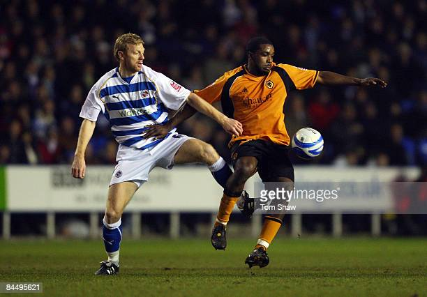 Brynjar Gunnarsson of Reading tussles with Sylvan EbanksBlake of Wolves during the Coca Cola Championship match between Reading and Wolverhampton...