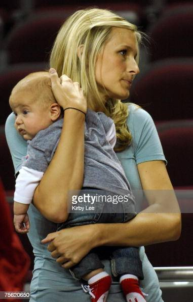 Brynn Cameron holds her son Cole Cameron Leinart during ...