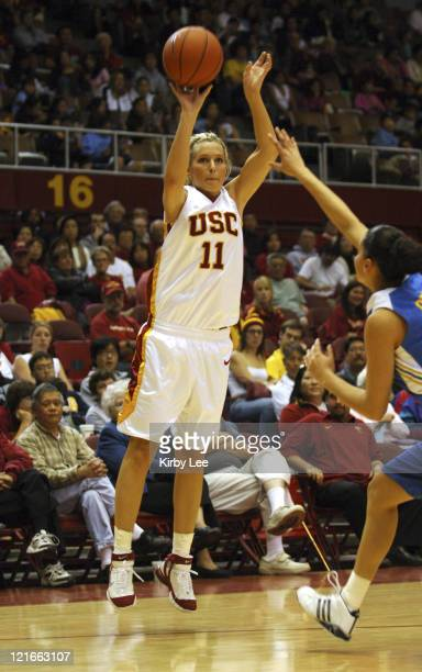Brynn Cameron of USC shoots a 3point shot during 7370 victory over UCLA in Pacific10 Conference women's basketball game at the Sports Arena in Los...