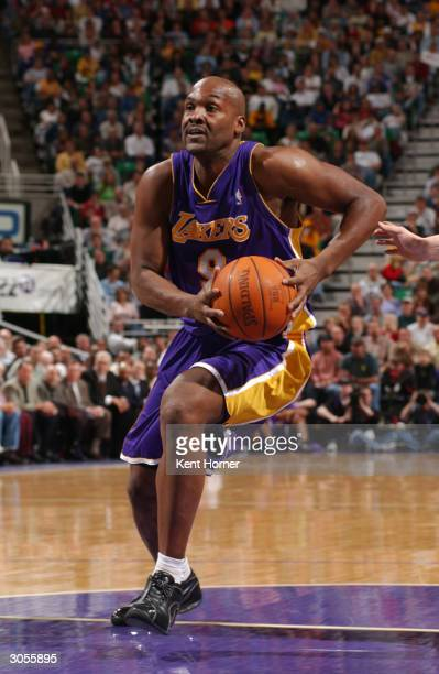 Bryon Russell of the Los Angeles Lakers drives to the basket against the Utah Jazz on March 8 2004 at the Delta Center in Salt Lake City Utah NOTE TO...