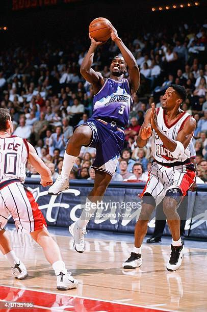 Bryon Russell of the Utah Jazz shoots during the game against the Houston Rockets on April 30, 1999 at Compaq Center in Houston, Texas.