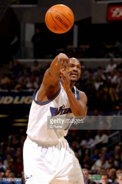 Bryon Russell of the Washington Wizards passes the ball against the New Orleans Hornets on February 1 2003 at the MCI Center in Washington DC NOTE TO...