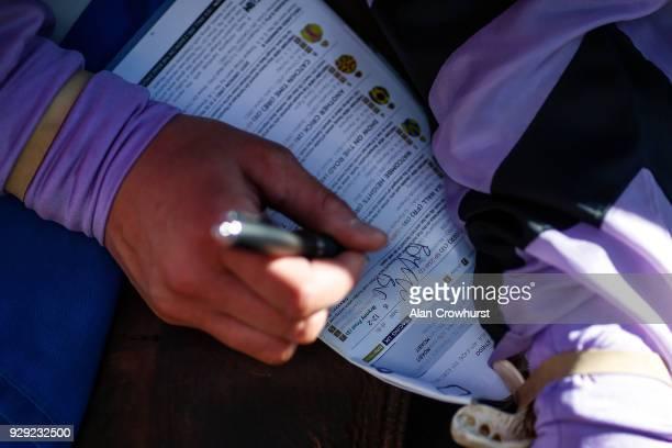 Bryony Frost autographs a racecard at Wincanton racecourse on March 8 2018 in Wincanton England