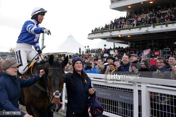Bryony Frost celebrates after riding Frodon to win The Ryanair Chase at Cheltenham Racecourse on March 14, 2019 in Cheltenham, England.