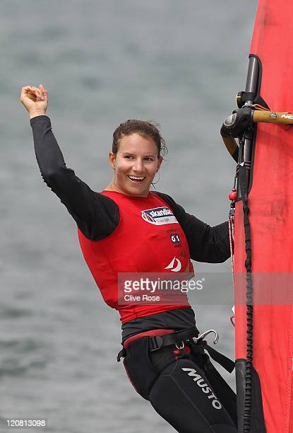 Bryony Shaw of Great Britain celebrates her bronze medal in the RSX Womens Class medal race on day ten of the Weymouth and Portland International...