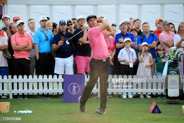 Bryson De Chambeau hits a shot watched by renowned coach Claude Harmon III entertain the crowds during 'The Star Clinic Science of Golf' after the...