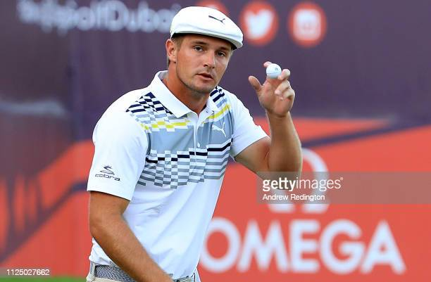 Bryson de Chambeau of the United States acknowledges the crowd on the 18th hole during the second round of the Omega Dubai Desert Classic at [Venue]...