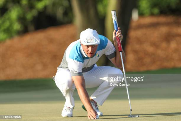 Bryson De Chambeau of the United States lines up a putt on the par 4 first hole during the final round of the 2019 Arnold Palmer Invitational at the...