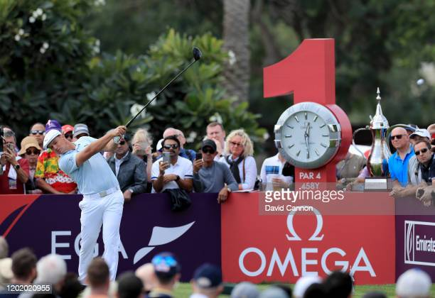 Bryson De Chambeau of the United States plays his tee shot on the first hole during the final round of the Omega Dubai Desert Classic on the Majlis...