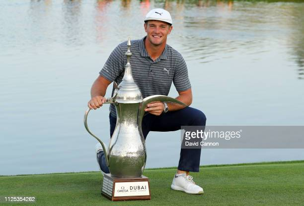 Bryson De Chambeau of the United States poses with the trophy after the final round of the Omega Dubai Desert Classic on the Majlis Course at the...