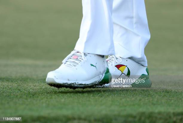 Bryson De Chambeau of the United States wears a pair of specially logo'd golf shoes remembering Arnold Palmer on the par 4 first hole during the...