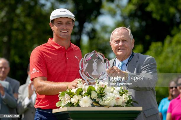 Bryson DeChambeau and Jack Nicklaus pose with the Memorial Tournament trophy after winning the second round playoff of the Memorial Tournament at...