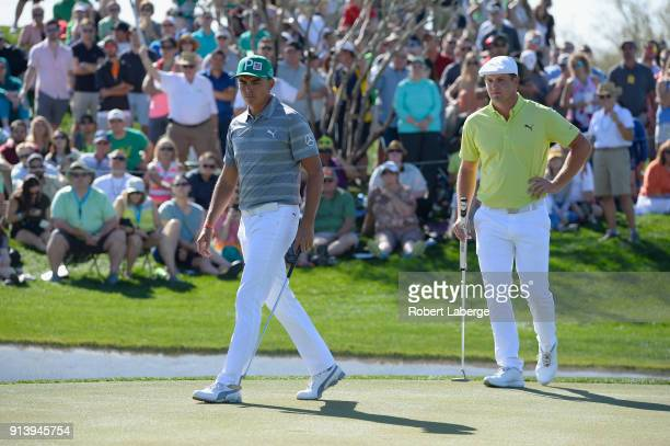 Bryson DeChambeau and Rickie Fowler line up their putts on the sixth hole during the Waste Management Phoenix Open at TPC Scottsdale on February 3...
