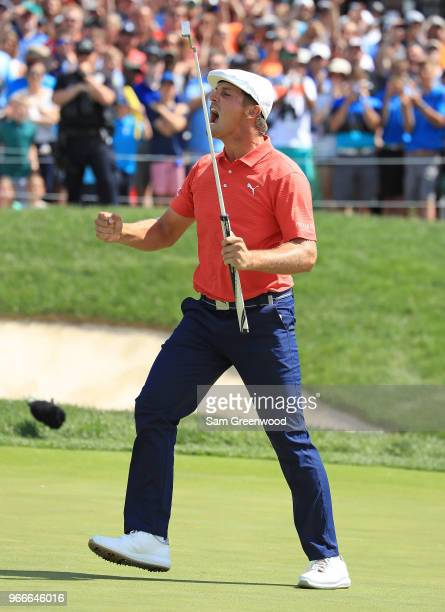 Bryson DeChambeau celebrates after winning in a playoff against Byeong-Hun An of South Korea during the final round of The Memorial Tournament...