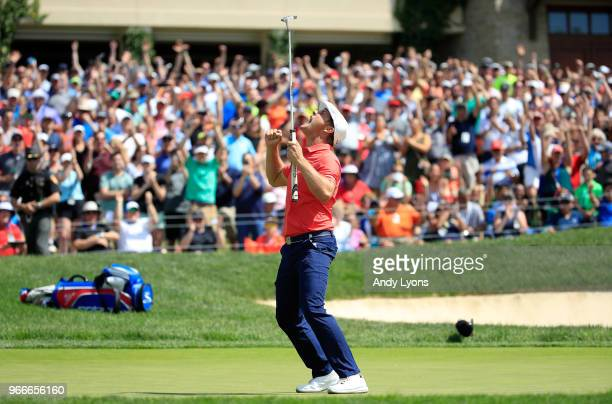 Bryson DeChambeau celebrates after winning in a playoff against ByeongHun An of South Korea during the final round of The Memorial Tournament...