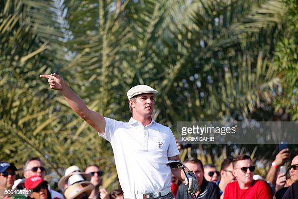 US Bryson Dechambeau gestures after playing a shot during the Abu Dhabi Golf Championship in the capital of the United Arab Emirates on January 23...