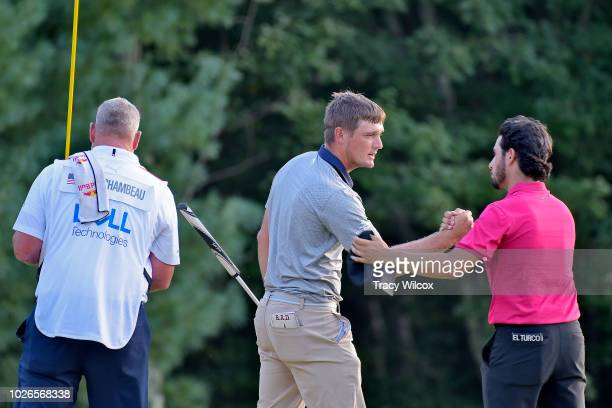 Bryson DeChambeau greets his playing partner Abraham Ancer of Mexico during the final round of the Dell Technologies Championship at TPC Boston on...