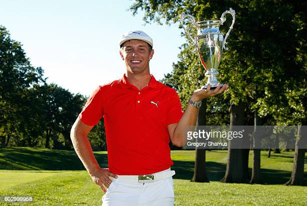 Bryson DeChambeau holds up the championship trophy after winning the Webcom Tour 2016 DAP Championship at the Canterbury Golf Club on September 11...