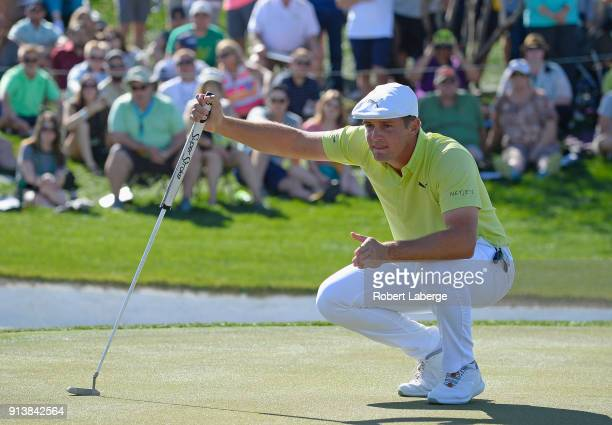 Bryson DeChambeau lines up a birdie putt on the eighth hole during the third round of the Waste Management Phoenix Open at TPC Scottsdale on February...