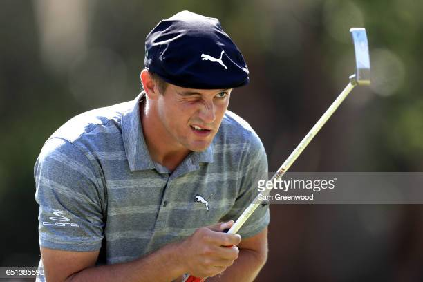 Bryson DeChambeau lines up a putt on the 17th green during the second round of the Valspar Championship at Innisbrook Resort Copperhead Course on...