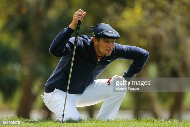 Bryson DeChambeau looks over a putt on the second green during the first round of the Valspar Championship at Innisbrook Resort Copperhead Course on...