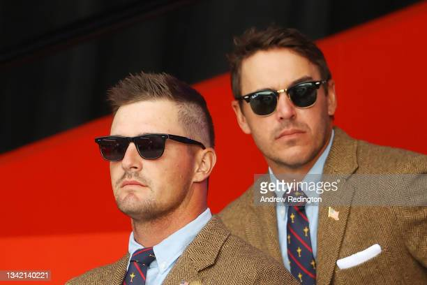 Bryson DeChambeau of team United States and Brooks Koepka of team United States attend the opening ceremony for the 43rd Ryder Cup at Whistling...
